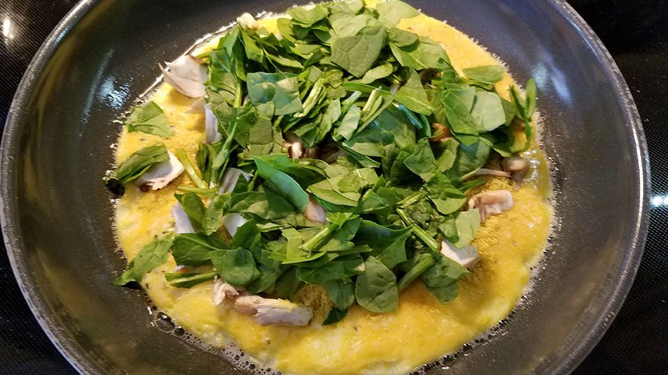 Spinach mushroom 3-egg omelet in process