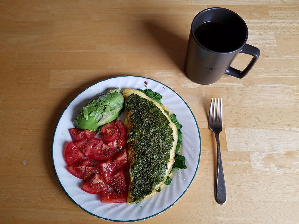 Spinach mushroom 3-egg omelet, tomato, half avocado, herbal tea with collagen
