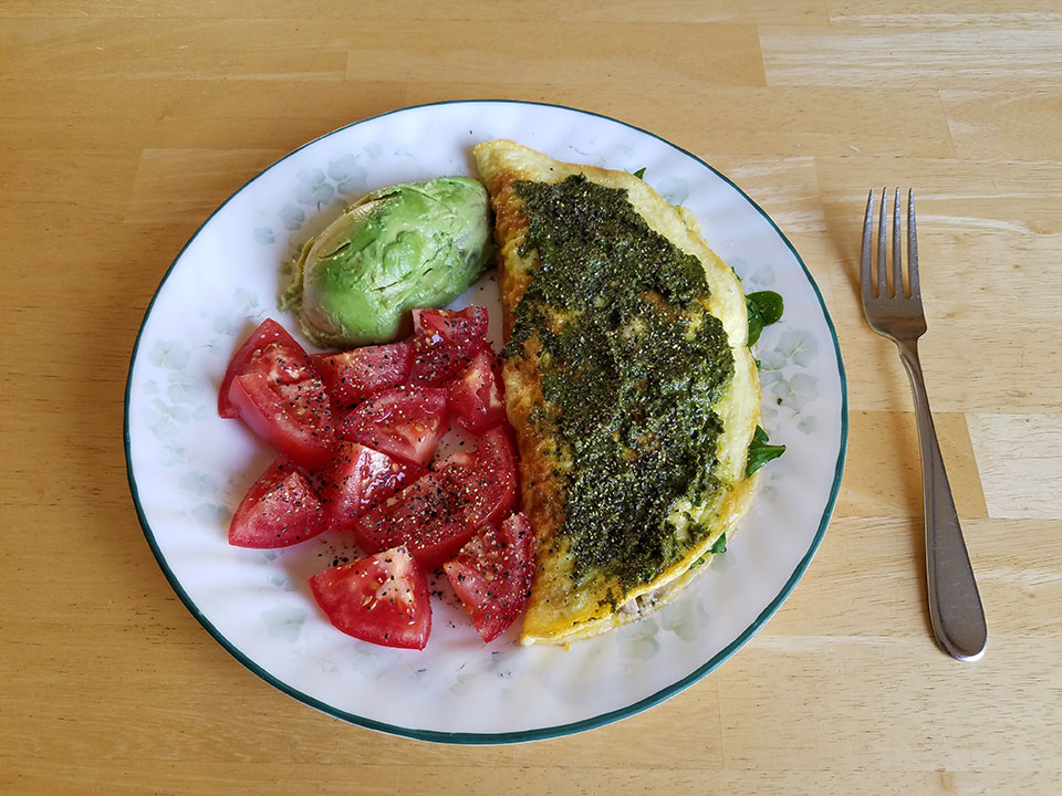 3-egg spinach mushroom omelet with homemade pesto, tomato, 1/2 avocado
