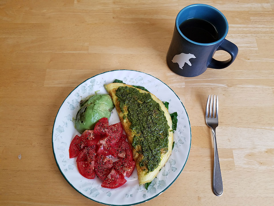 3-egg spinach mushroom omelet with pesto, tomato, avocado, herbal tea with 1/2 scoop collagen