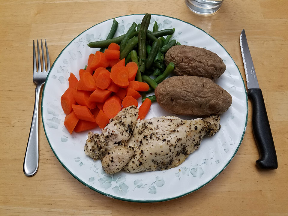 Chicken breast, baked potatoes, green beans, carrots