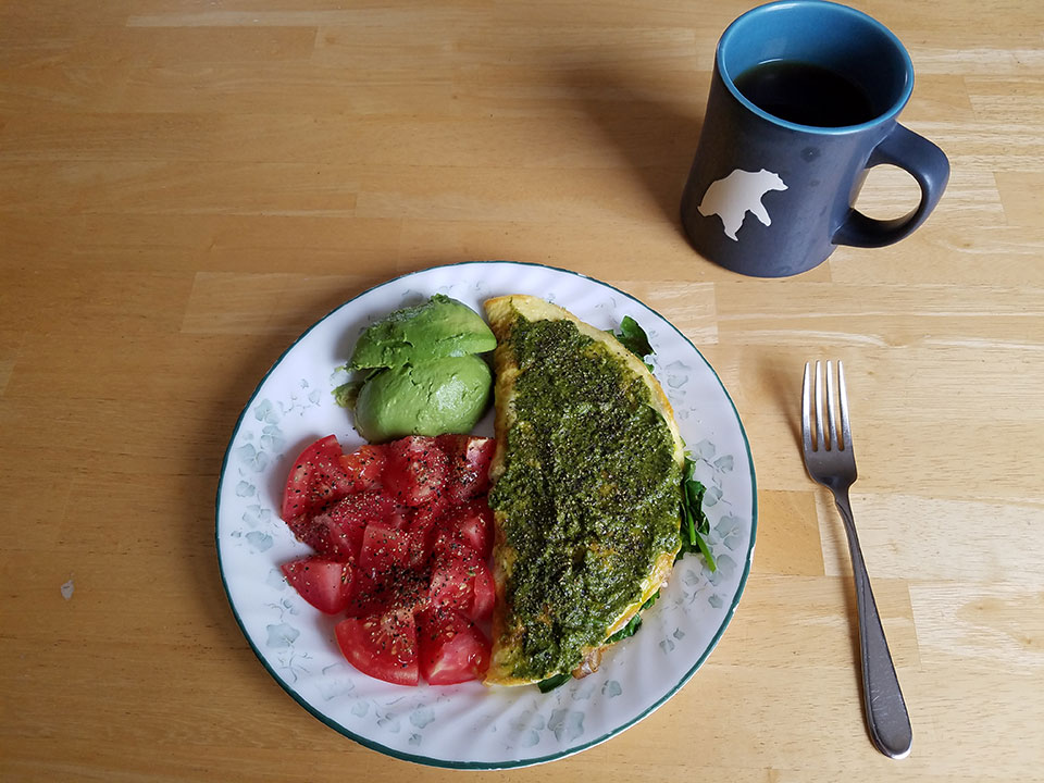 Coffee with 1/2 scoop collagen, 3-egg spinach mushroom omelet, tomato, avocado