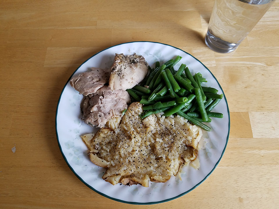 Chicken thighs (2), green beans, baked potato