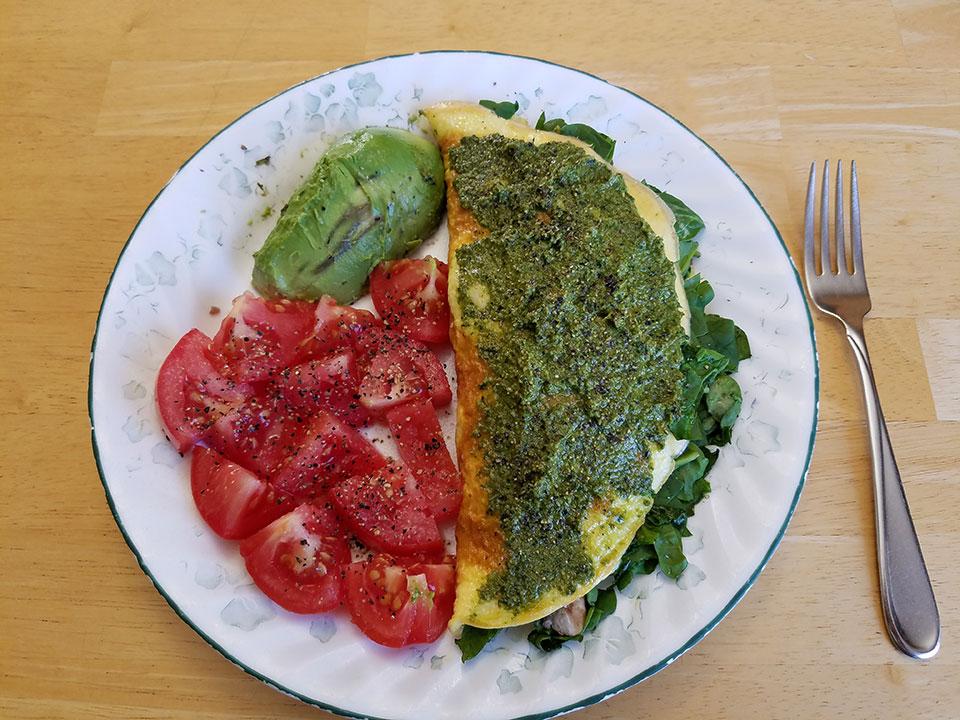 3-egg spinach mushroom ground beef omelet, tomato, avocado
