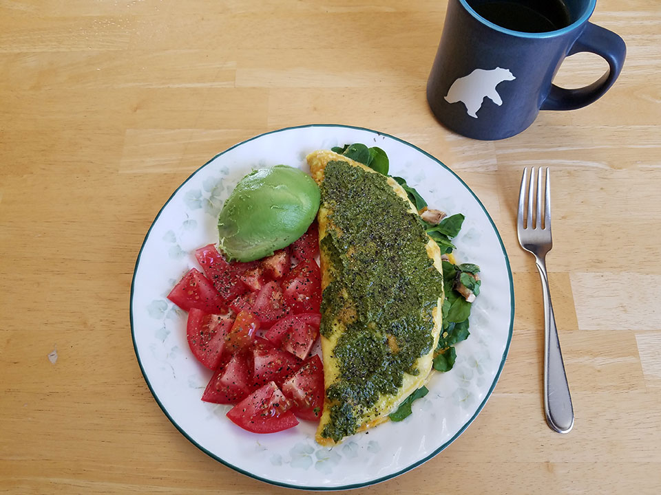 3-egg spinach mushroom omelet, homemade pesto, tomato, avocado, coffee with 1/2 scoop collagen