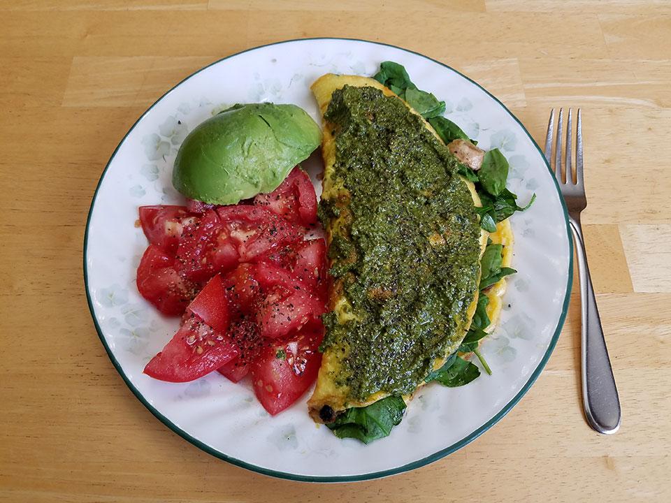 3-egg spinach mushroom omelet, tomato, avocado