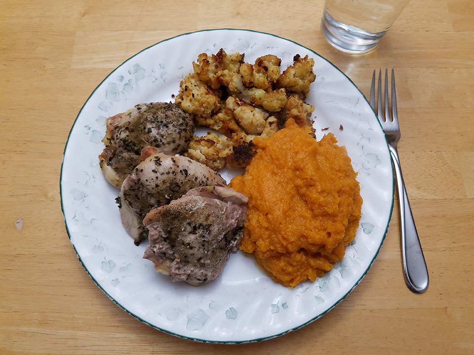 Chicken thighs (3), roasted cauliflower, sweet potatoes