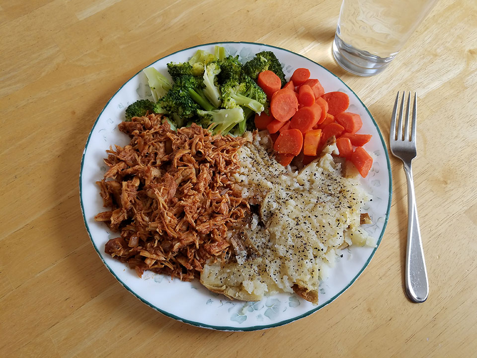 Pulled barbecue chicken, broccoli, carrots, baked potato