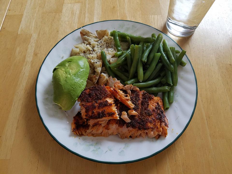Salmon, green beans, baked potato, avocado