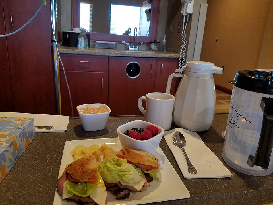 Roast beef sandwich on gluten-free bread, potato chips, soup, fresh berries, and the best coffee I've had in a long time!