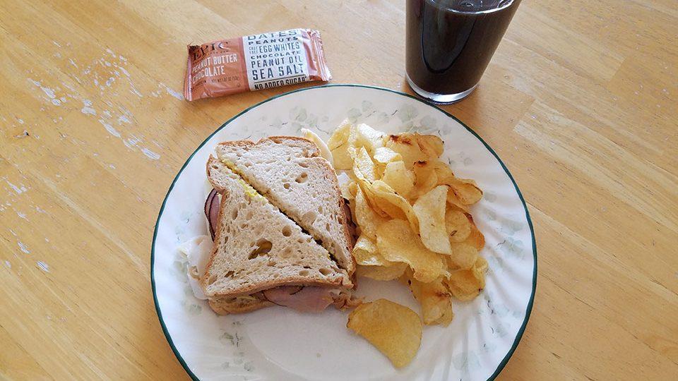 Box lunch from Black Hills Surgical Hospital - roast beef, turkey, swiss cheese sandwich on gluten-free bread, sea salt chips, protein bar, prune juice