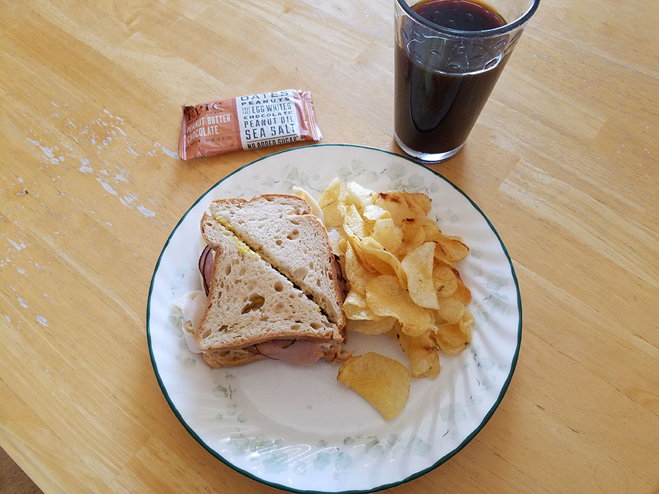 Box lunch from Black Hills Surgical Hospital - roast beef, turkey, swiss cheese sandwich on gluten-free bread, sea salt chips, protein bar, prune juice