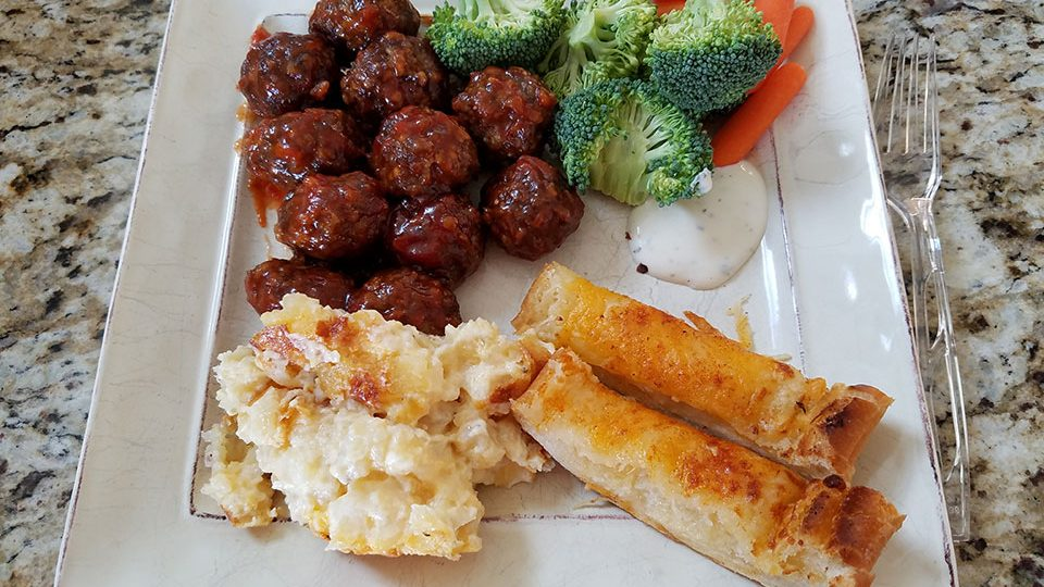 Church potluck at O'Shea's - meatballs, hashbrown casserole, broccoli, carrots, dip, cheesy bread